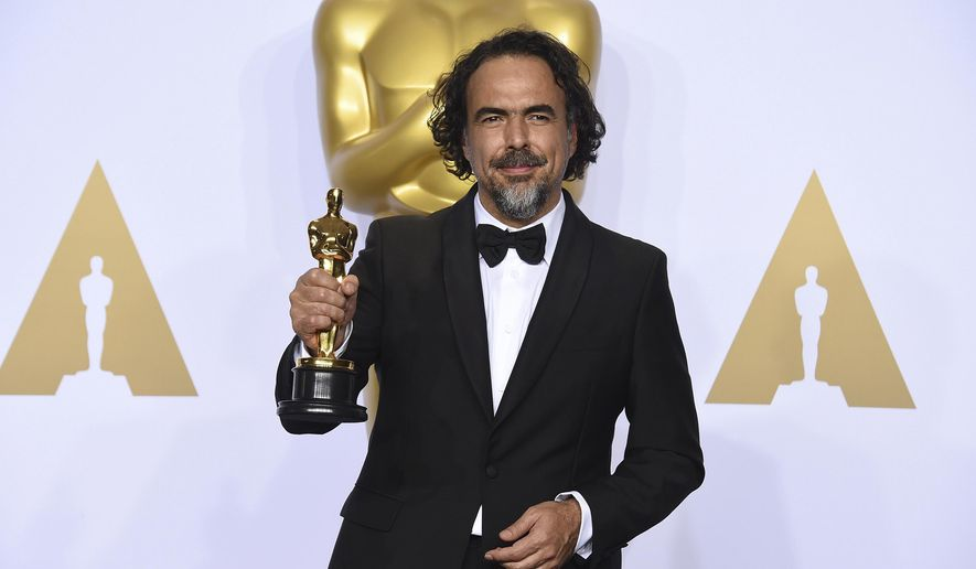 """FILE - In this Feb. 28, 2016 file photo, Alejandro G. Inarritu poses in the press room with the award for best director for """"The Revenant"""" at the Oscars in Los Angeles. Inarritu's groundbreaking virtual reality installation """"CARNE y ARENA (Virtually Present, Physically Invisible),"""" will be awarded a special Oscar for its visionary and powerful storytelling. The Board of Governors of the Academy of Motion Picture Arts and Sciences said Friday, Oct. 27, 2017, that the Oscar statuette will be presented at the film academy's 9th annual Governor's Awards in Los Angeles on Nov. 11. (Photo by Jordan Strauss/Invision/AP, File)"""