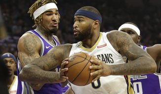 New Orleans Pelicans forward DeMarcus Cousins, right, goes to the basket against Sacramento Kings center Willie Cauley-Stein during the first quarter of an NBA basketball game Thursday, Oct. 26, 2017, in Sacramento, Calif. (AP Photo/Rich Pedroncelli)