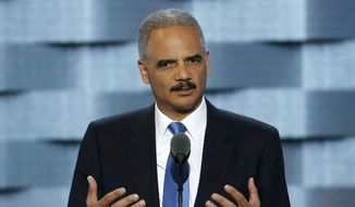 In this July 26, 2016 file photo, former Attorney General Eric Holder speaks during the second day of the Democratic National Convention in Philadelphia. (AP Photo/J. Scott Applewhite, File)