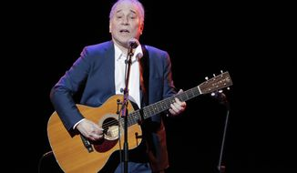 In this Sept. 22, 2016 file photo, musician Paul Simon performs during the Global Citizen Festival in New York. (AP Photo/Julie Jacobson, File)