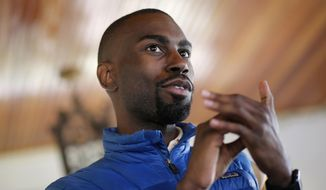 FILE - In this March 26, 2016, file photo, Black Lives Matter activist DeRay Mckesson chats with campaign volunteers in Baltimore. A federal judge approved a class-action settlement Friday, Oct. 27, 2017, that awards up to $1,000 in cash to dozens of protesters who claim police violated their civil rights and used excessive force in arresting them after a deadly police shooting in Louisiana. Mckesson is among 69 arrested protesters eligible for payments ranging from $500 to $1,000 now that U.S. District Judge John W. deGravelles has given his final approval.   (AP Photo/Patrick Semansky, File)