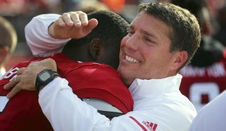 Rutgers coach Chris Ash, right, hugs Deonte Roberts as the seconds click down in the 14-12 victory over Purdue in an NCAA college football game, Saturday, Oct. 21, 2017, in Piscataway, N.J. (John Munson/NJ Advance Media via AP)