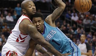 Houston Rockets' PJ Tucker, left, fouls Charlotte Hornets' Malik Monk, right, during the first half of an NBA basketball game in Charlotte, N.C., Friday, Oct. 27, 2017. (AP Photo/Chuck Burton)