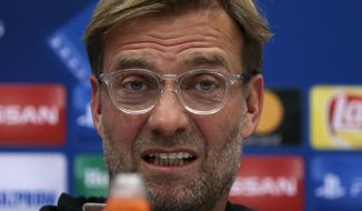 FILE - In this file photo dated Monday, Sept. 25, 2017, Liverpool's manager Jurgen Klopp answers questions during a news conference ahead of the Champions League soccer match between Spartak Moscow and Liverpool in Moscow, Russia.  Klopp and Huddersfield manager David Wagner are best friends off the field, but will be rival managers when Liverpool face-off against Huddersfield on upcoming Saturday Oct. 28, 2017.  (AP Photo/Ivan Sekretarev, FILE)