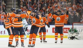 Edmonton Oilers players celebrate a goal against the Dallas Stars during the third period of an NHL hockey game in Edmonton, Alberta, Thursday, Oct. 26, 2017.  (Jason Franson/The Canadian Press via AP)