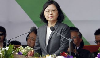 FILE - In this Oct. 10, 2017 file photo, Taiwan's President Tsai Ing-wen delivers a speech during the National Day celebrations in front of the Presidential Building in Taipei. Taiwan's President Tsai  is setting off for the United States and three South Pacific nations in an effort to crack the diplomatic isolation imposed by rival China. Tsai will visit the Marshall and Solomon Islands along with Tuvalu starting from Saturday, Oct. 28. (AP Photo/Chiang Ying-ying, File)