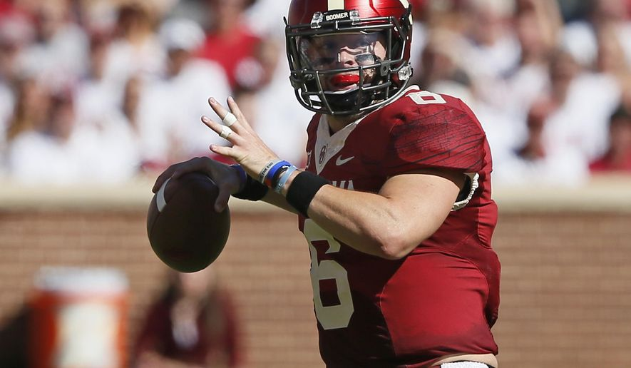 FILE - In this Saturday, Oct. 7, 2017 file photo, Oklahoma quarterback Baker Mayfield (6) looks for a receiver in the first quarter of an NCAA college football game against Iowa State in Norman, Okla. Oklahoma quarterback Baker Mayfield appears to finally have moved on after spending years being angry with Texas Tech. Mayfield walked on at Texas Tech but wasn't offered a scholarship. He still lobbed verbal jabs at Tech after he left for Oklahoma because he lost a year of eligibility in the move. He eventually got the year back and thrived with the Sooners. Oklahoma plays Texas Tech on Saturday, Oct. 28, 2017. (AP Photo/Sue Ogrocki, File)