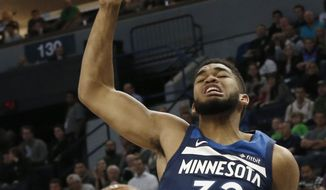 Minnesota Timberwolves' Karl-Anthony Towns dunks during the first half of an NBA basketball game against the Oklahoma City Thunder Friday, Oct. 27, 2017, in Minneapolis. Towns led his team with 33 points in the Timberwolves' 119-116 win. (AP Photo/Jim Mone)