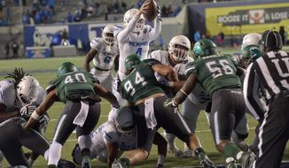 Memphis quarterback Riley Ferguson (4) jumps over the goal line to score a touchdown in the second half of an NCAA college football game against Tulane Friday, Oct. 27, 2017, in Memphis, Tenn. (AP Photo/Brandon Dill)