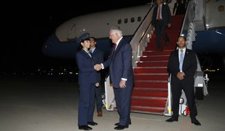 Secretary of State Rex Tillerson is greeted as he steps off his plane as he arrives, Thursday, Oct. 26, 2017, at Andrews Air Force Base, Md. Tillerson is returning from a seven country trip. (AP Photo/Alex Brandon, Pool)