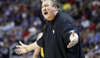 FILE - In this March 23, 2017, file photo, West Virginia head coach Bob Huggins yells from the sideline during the first half of an NCAA Tournament college basketball regional semifinal game against Gonzaga in San Jose, Calif. Huggins says he's not sure whether West Virginia will use its full-court press on every defensive possession this season due to roster changes. (AP Photo/Tony Avelar, File)