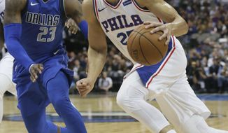 Philadelphia 76ers guard Ben Simmons (25) drives against Dallas Mavericks guard Wesley Matthews (23) during the first half of an NBA basketball game in Dallas, Saturday, Oct. 28, 2017. (AP Photo/LM Otero)