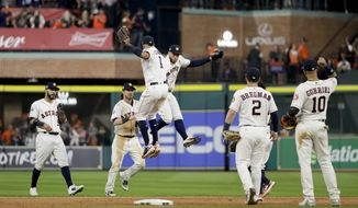 Members of the Houston Astros celebrate after their win against the Los Angeles Dodgers during Game 3 of baseball's World Series Friday, Oct. 27, 2017, in Houston. The Astros won 5-3 to take a 2-1 lead in the series. (AP Photo/Matt Slocum)