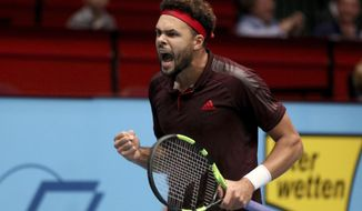 Jo Wilfried Tsonga of France shouts  during his semifinal match against Philipp Kohlschreiber of Germany at the Erste Bank Open tennis tournament in Vienna, Austria, Saturday, Oct. 28, 2017. (AP Photo/Ronald Zak)