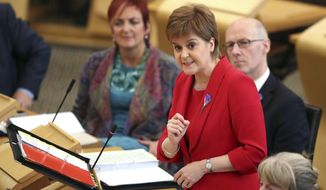 "First Minister Nicola Sturgeon during First Minister's Questions at the Scottish Parliament in Edinburgh, Scotland, Thursday Oct. 26, 2017.  Scottish leader Nicola Sturgeon on Friday Oct. 27, 2017, demanded that British Prime Minister Theresa May provide ""urgent clarity"" on plans for a transition period after Britain leaves the European Union, saying she is concerned the country is heading for a ""no-deal"" Brexit. (Jane Barlow/PA via AP)"
