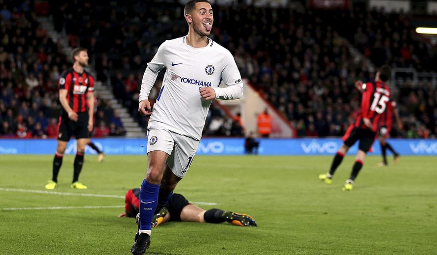Chelsea's Eden Hazard celebrates scoring his side's first goal of the game during their English Premier League soccer match against AFC Bournemouth at the Vitality Stadium, Bournemouth, England, Saturday, Oct. 28, 2017. (Steven Paston/PA via AP)