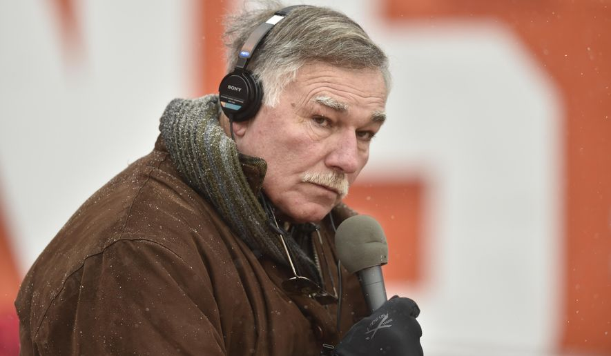 FILE - In this Dec. 11, 2016, file photo, former Cleveland Browns lineman and current radio broadcaster Doug Dieken works from the field before an NFL game against the Cincinnati Bengals in Cleveland.  Dieken did not travel with the team to London and will miss his first broadcast in nearly 30 years on Sunday.  Dieken was hospitalized this week with an undisclosed illness, preventing him from accompanying the Browns for their matchup against the Minnesota Vikings, the team's first regular-season international game. (AP Photo/David Richard, File)