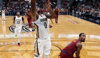 New Orleans Pelicans forward DeMarcus Cousins (0) drives to the basket in front of Cleveland Cavaliers guard JR Smith in the first half of an NBA basketball game in New Orleans, Saturday, Oct. 28, 2017. (AP Photo/Gerald Herbert)