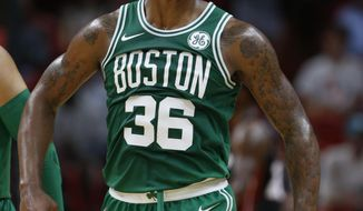 Boston Celtics guard Marcus Smart reacts after scoring during the first half of an NBA basketball game against the Miami Heat, Saturday, Oct. 28, 2017, in Miami. (AP Photo/Wilfredo Lee)
