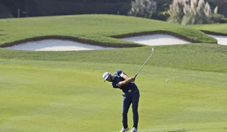 World number one golfer Dustin Johnson hits from the fairway during the third round of the 2017 WGC-HSBC Champions golf tournament held at the Sheshan International Golf Club in Shanghai, China, Saturday, Oct. 28, 2017. (AP Photo/Ng Han Guan)