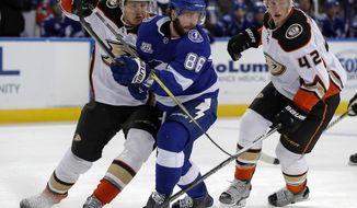 Anaheim Ducks' Hampus Lindholm (47), of Sweden, and Josh Manson (42) defend against Tampa Bay Lightning's Nikita Kucherov, of Russia, during the second period of an NHL hockey game Saturday, Oct. 28, 2017, in Tampa, Fla. The Ducks won 4-1. (AP Photo/Mike Carlson)