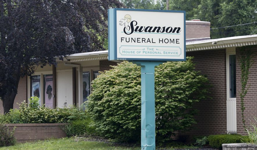 In a July 12, 2017 file photo, the Swanson Funeral Home is seen on Martin Luther King Avenue in Flint, Mich. The state has shut down the funeral home, saying maggots were in a garage where unrefrigerated bodies were being stored. (Terray Sylvester/The Flint Journal-MLive.com via AP) **FILE**