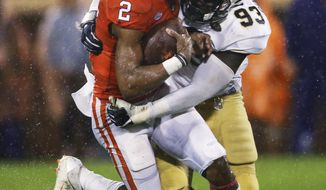 Clemson quarterback Kelly Bryant (2) is stopped by Georgia Tech defensive lineman Antonio Simmons (93) in the first half of an NCAA college football game Saturday, Oct. 28, 2017, in Clemson, S.C. (AP Photo/John Bazemore)