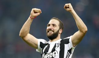 Juventus' Gonzalo Higuain celebrates after the end of the Serie A soccer match between AC Milan and Juventus, at the Milan San Siro stadium, Italy, Saturday, Oct. 28, 2017. Juventues won the game 2-0, Higuain scored both goals. (AP Photo/Antonio Calanni)