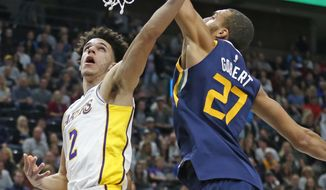 Los Angeles Lakers guard Lonzo Ball (2) lays up the ball as Utah Jazz center Rudy Gobert (27) defends in the first half during an NBA basketball game Saturday, Oct. 28, 2017, in Salt Lake City. (AP Photo/Rick Bowmer)