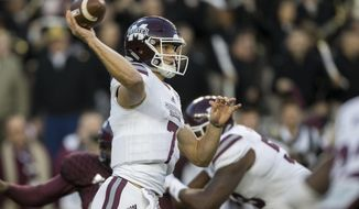 Mississippi State quarterback Nick Fitzgerald (7) pass downfield against Texas A&M during the first quarter of an NCAA college football game on Saturday, Oct. 28, 2017, in College Station, Texas. (AP Photo/Sam Craft)