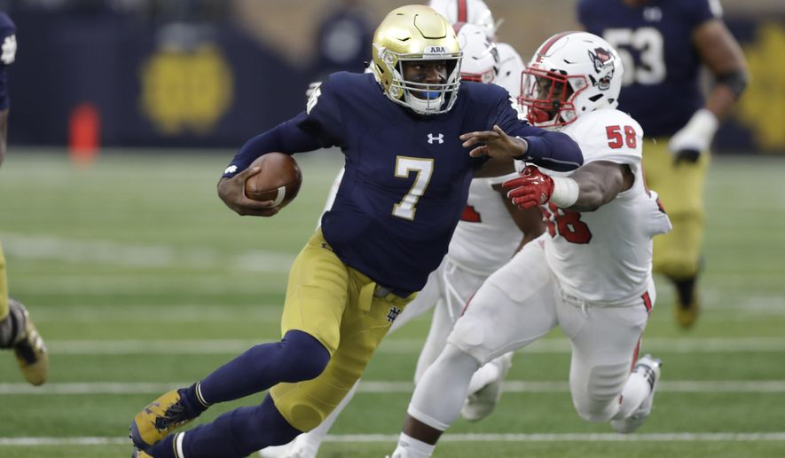 Notre Dame quarterback Brandon Wimbush is tackled by North Carolina State's Airius Moore during the first half of an NCAA college football game, Saturday, Oct. 28, 2017, in South Bend, Ind. (AP Photo/Darron Cummings)