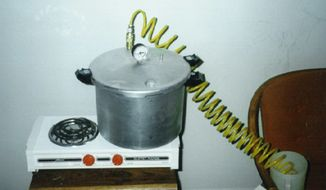 This 1997 photo provided by the Drug Enforcement Administration shows a methamphetamine lab found in an Oklahoma motel. Agents say active ingredients found in normal household items like starter fluid, lithium batteries, styrofoam cups and over-the-counter decongestants could be used in the apparatus to make the drug. (Drug Enforcement Administration via AP) **FILE**
