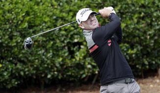 Ryan Armour watches his drive from the first tee during the third round of the Sanderson Farms Championship golf tournament in Jackson, Miss., Saturday, Oct. 28, 2017. (AP Photo/Rogelio V. Solis)