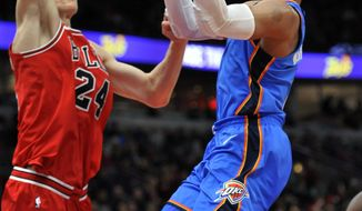 Oklahoma City Thunder's Russell Westbrook (0) goes up to shoot against Chicago Bulls' Lauri Markkanen (24), of Finland, during the second half of an NBA basketball game Saturday, Oct. 28, 2017, in Chicago. (AP Photo/Paul Beaty)