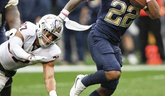 Pittsburgh running back Darrin Hall (22) runs away from Virginia linebacker Jordan Mack (37) on his way to a touchdown during the first half of an NCAA college football game, Saturday, Oct. 28, 2017, in Pittsburgh. (AP Photo/Keith Srakocic)