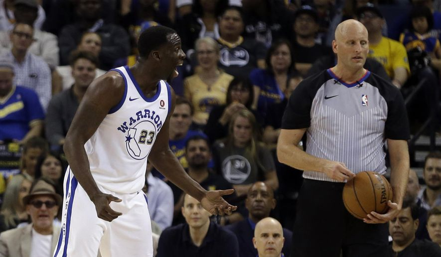 Golden State Warriors' Draymond Green, left, argues with a referee during the first half of an NBA basketball game against the Washington Wizards, Friday, Oct. 27, 2017, in Oakland, Calif. (AP Photo/Ben Margot)