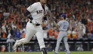 Houston Astros' Yuli Gurriel reacts after hitting a home run during the first inning of Game 3 of baseball's World Series against the Los Angeles Dodgers Friday, Oct. 27, 2017, in Houston. (AP Photo/David J. Phillip)