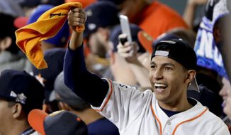 A Houston Astros fan cheers during the seventh inning of Game 3 of baseball's World Series against the Los Angeles Dodgers Friday, Oct. 27, 2017, in Houston. (AP Photo/Charlie Riedel)