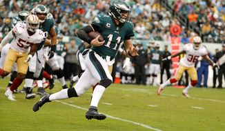 Philadelphia Eagles quarterback Carson Wentz (11) runs the ball during the first half of an NFL football game against the San Francisco 49ers, Sunday, Oct. 29, 2017, in Philadelphia. (AP Photo/Chris Szagola)