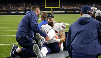 Chicago Bears tight end Zach Miller (86) taken off the field on a cart, after injuring his leg in the second half of an NFL football game against the New Orleans Saints in New Orleans, Sunday, Oct. 29, 2017. Miller hurt his leg on an apparent touchdown reception that was overturned on review. (AP Photo/Butch Dill)