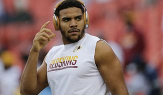 Washington Redskins tight end Jordan Reed (86) reaches for his headphones during the warm up period before an NFL football game against the Dallas Cowboys in Landover, Md., Sunday, Oct. 29, 2017. (AP Photo/Mark Tenally)