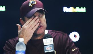 Washington Redskins head coach Jay Gruden answers reporters questions at a press conference after an NFL football game against the XXX in Landover, Md., Sunday, Oct. 29, 2017. The Dallas Cowboy defeated the Washington Redskins 33-19. (AP Photo/Alex Brandon)