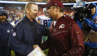 Dallas Cowboys head coach Jason Garrett greets Washington Redskins head coach Jay Gruden after an NFL football game against in Landover, Md., Sunday, Oct. 29, 2017. The Dallas Cowboy defeated the Washington Redskins 33-19. (AP Photo/Patrick Semansky)