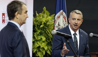 Republican gubernatorial candidate Ed Gillespie (right) has accused Democratic rival Ralph Northam of enabling the violent MS-13 transnational criminal gang, and now Mr. Northam's allies are calling Mr. Gillespie an enabler of racial violence in Virginia. (Associated Press/File)