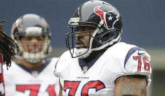 Houston Texans tackle Duane Brown (76) on the field before an NFL football game against the Seattle Seahawks, Sunday, Oct. 29, 2017, in Seattle. (AP Photo/Stephen Brashear)