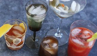 Mixed cocktails are shown, from left, an old fashioned, a vodka gimlet, a Bull Shot, a dry martini and a bloody mary. (AP Photo/Matthew Mead) ** FILE **