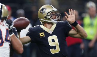 New Orleans Saints quarterback Drew Brees (9) passes in the first half of an NFL football game against the Chicago Bears in New Orleans, Sunday, Oct. 29, 2017. (AP Photo/Butch Dill)