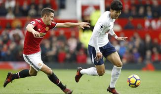 Tottenham Hotspur's Son Heung-Min, right, gets away from Manchester United's Ander Herrera, during the English Premier League soccer match between Manchester United and Tottenham Hotspur,  at Old Trafford, in Manchester, England, Saturday, Oct.  28, 2017. (Martin Rickett/PA via AP)
