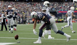 New England Patriots tight end Rob Gronkowski spikes the ball after catching a touchdown pass against the Los Angeles Chargers during the first half of an NFL football game, Sunday, Oct. 29, 2017, in Foxborough, Mass. (AP Photo/Steven Senne)