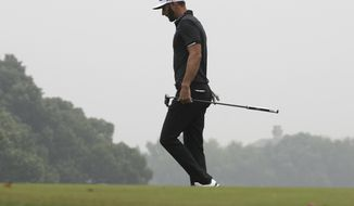Dustin Johnson of United States walks on the green during the final round of the 2017 WGC-HSBC Champions golf tournament held at the Sheshan International Golf Club in Shanghai, China, Sunday, Oct. 29, 2017. Johnson, the world's No. 1 player going for his third World Golf Championships title of the year, lost a six-shot lead Sunday. That matches the largest blown lead in the final round on the PGA Tour, most recently by Sergio Garcia at Quail Hollow in 2005 and Greg Norman in the 1996 Masters. (AP Photo/Ng Han Guan)